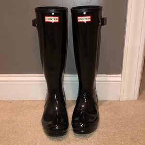 Black rubber Hunter boots with white socks